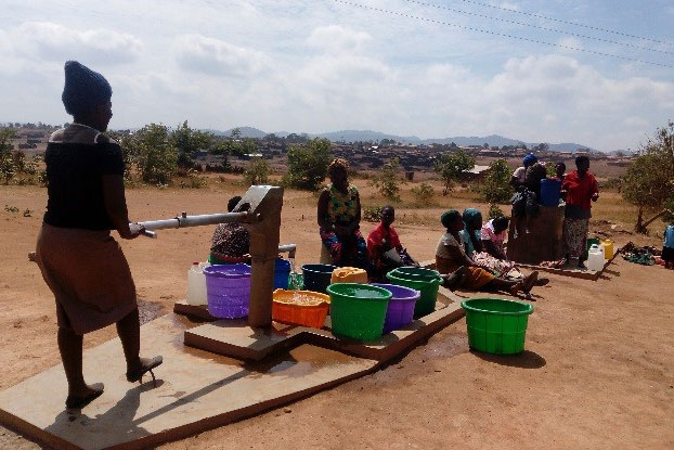 Women Drawing Water From The Borehole
