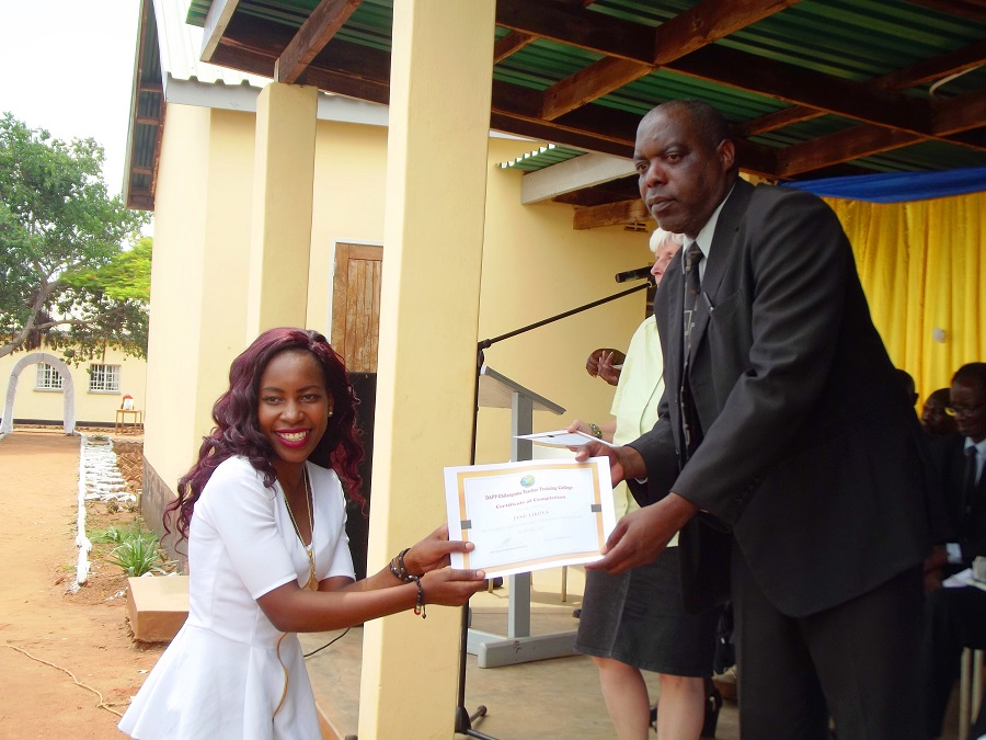 A Graduate Receiving Certificate During The Ceremony