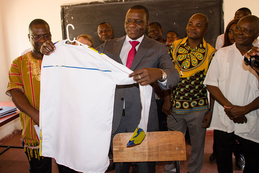 The Minister Of Labour Youth Sports And Manpower Development Appreciting Some Of The Products Produced By Students At Mikolongwe Vocational School