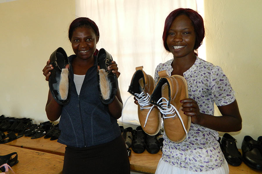 Shoe making students showcase products made during their training