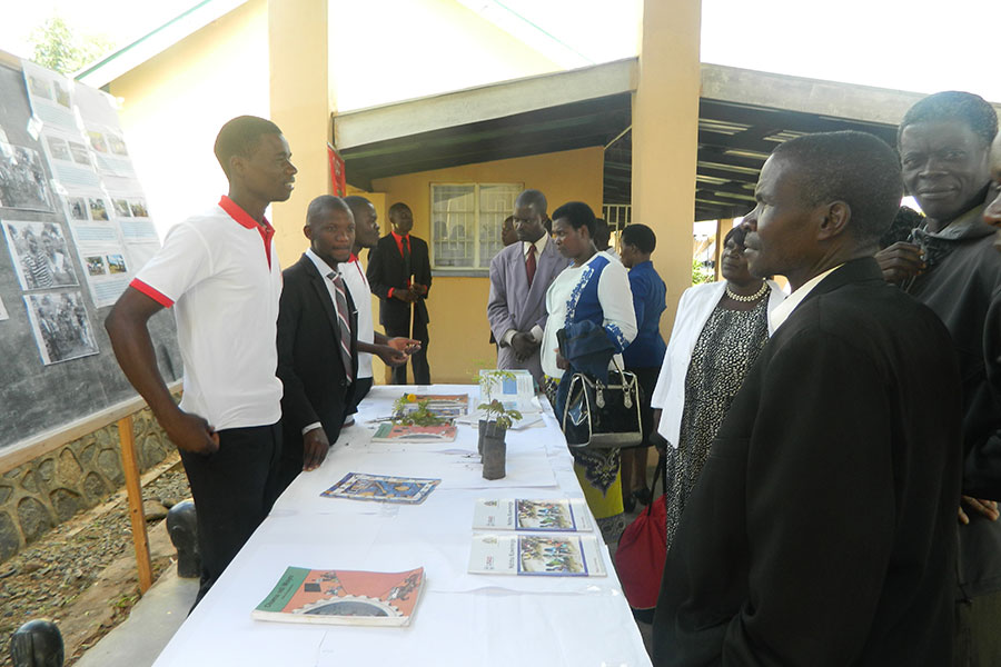 Guests visiting displays set by the college's students