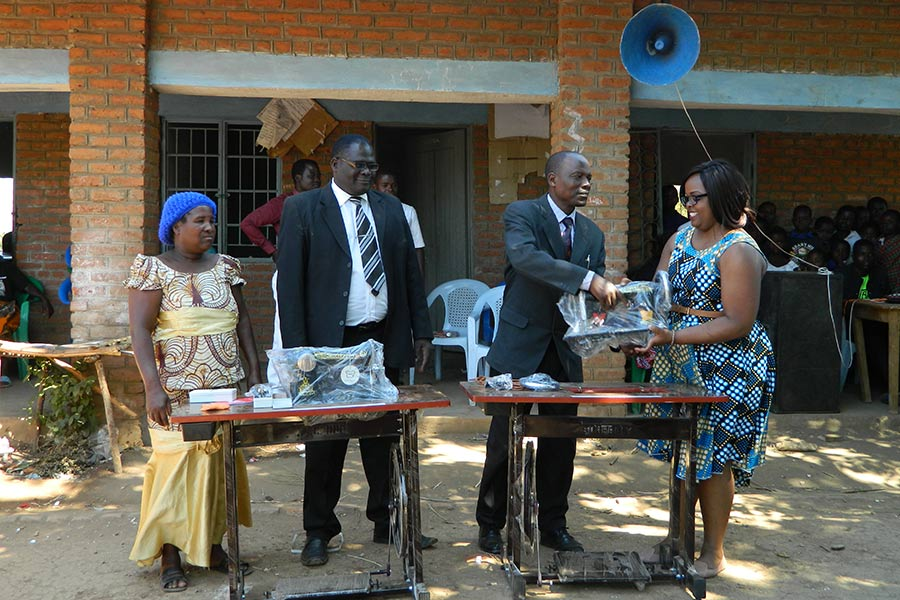 Febbie (Right) Hands Over Sewing Machines To The School
