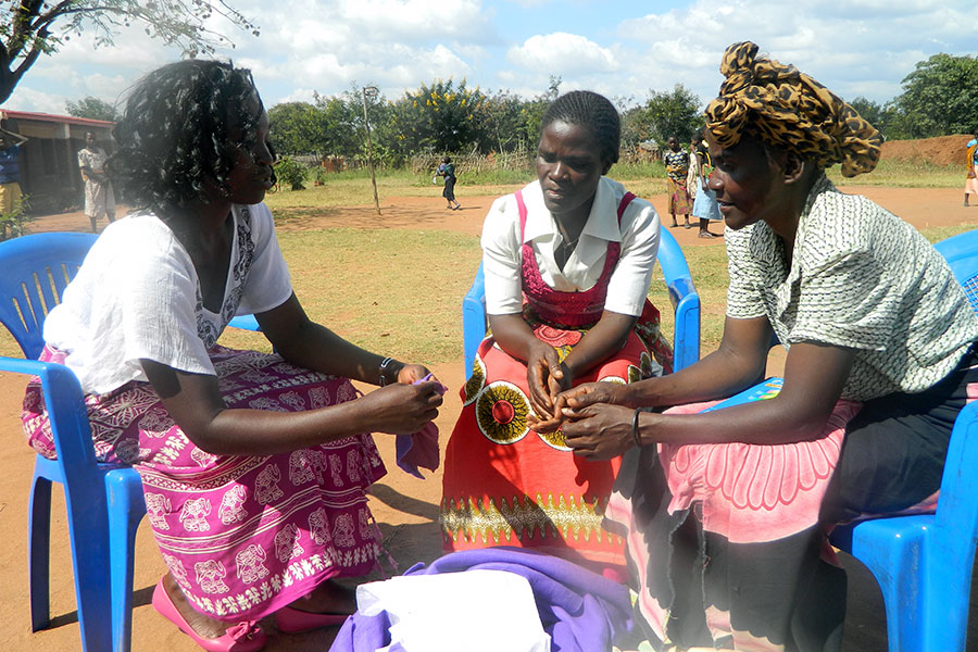 Agness and mother groups representatives sewing the pads