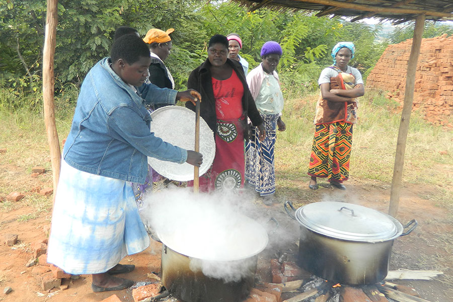 Women preparing porridge for learners