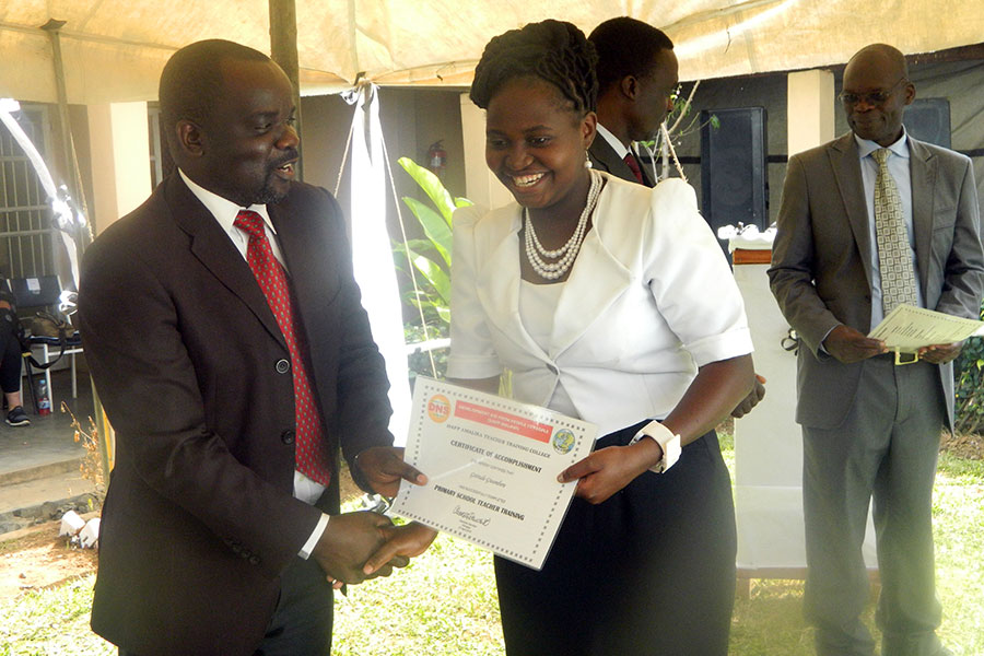 A graduating student teacher getting her certificate