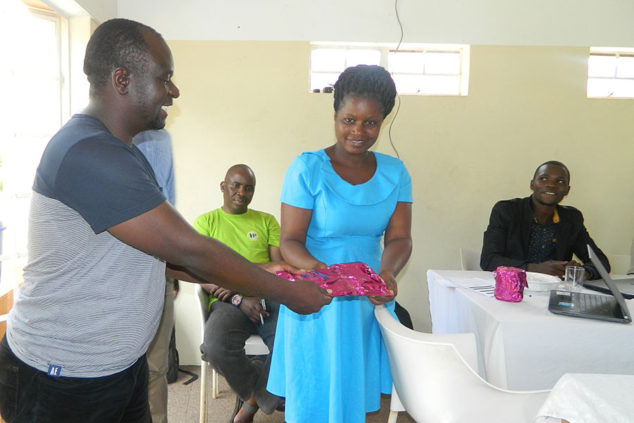 Mponya hands over a present to one of the active members at the training