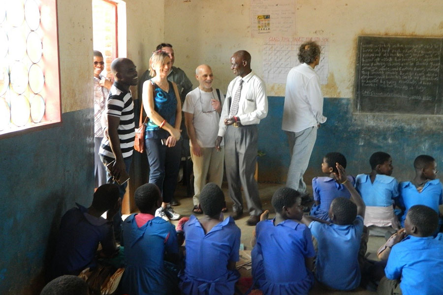 Bolin, Luppi, Stillo and Gesoaldi accompanied by Chisenjere Primary School staff inspect classes in session