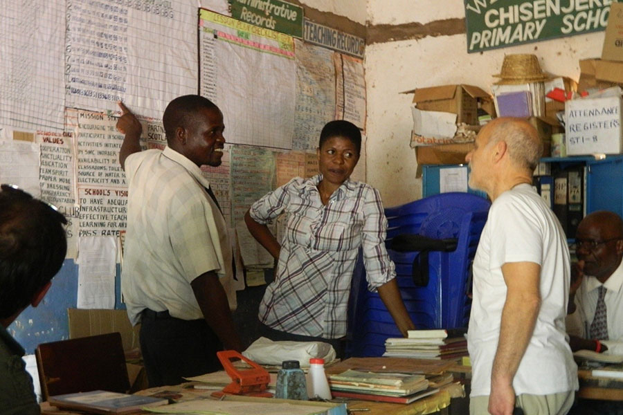 Chafikana and Banda explains to Stillo on how the 400 Primary Schools programme works