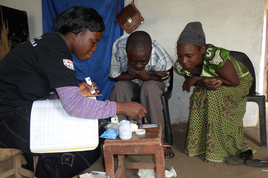 Janet (Left) conducting an infection test for a couple in Thyolo