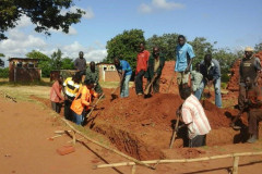 Community members digging a classroom block foundation at Masangano primary school in Ntchisi
