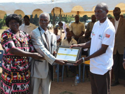 Traditional Authority Makhuwira receiving the ODF Certificate from Mr. Beston Chisamile